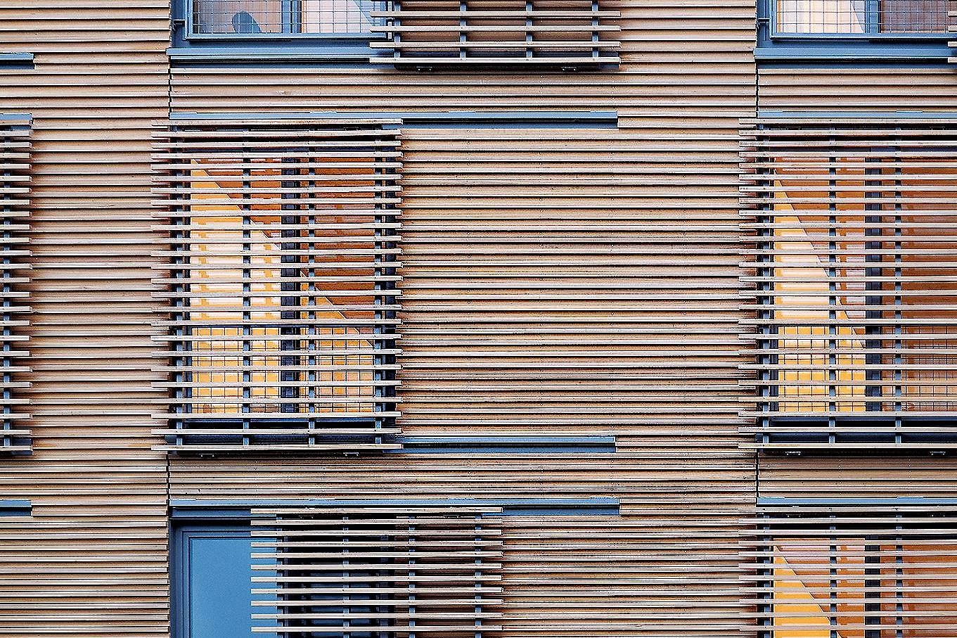 Cypress cladding and movable louvers.